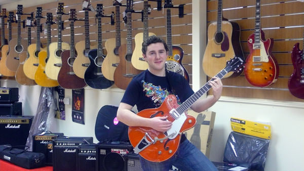 Daniel Corrigan of local band LoUiSe looks at the range of guitars at the new Music City shop located at Dungannon Enterprise Centre.